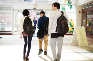 Students walking down a campus hallway