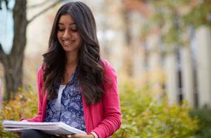 Student reading paperwork