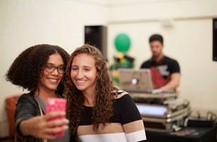Students taking selfies at an event