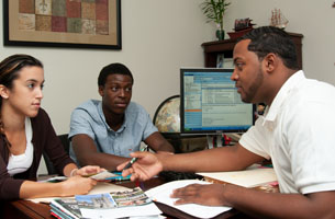 counselor meeting with students