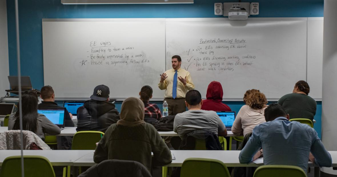 image of a professor teaching in front of their class in the school of business