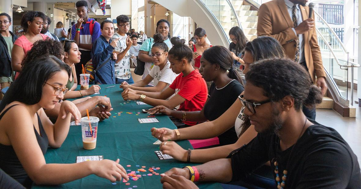 students playing bingo at a long table