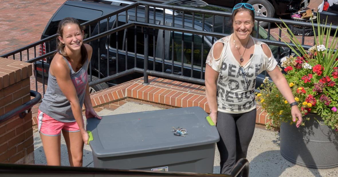 Mother and Daughter moving crate together on move-in day