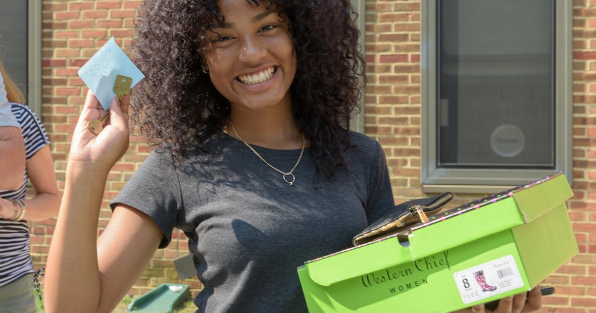 Student with key on Move-in Day