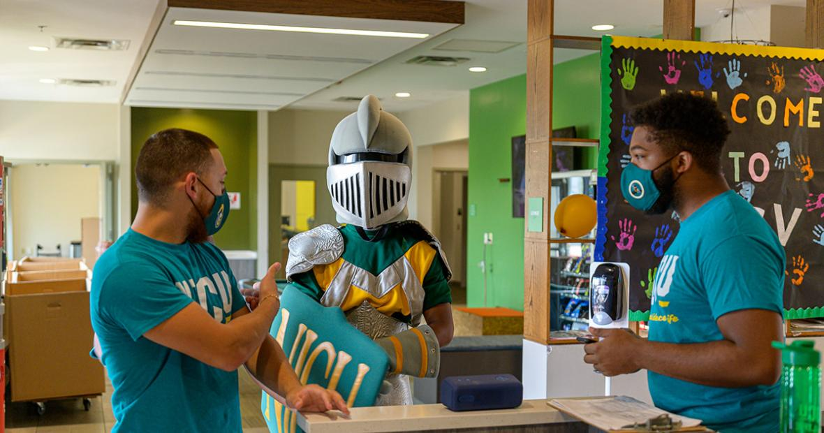 Resident Assistants Elias and Desmond with the NJCU mascot