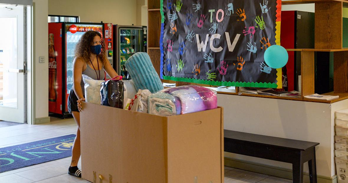 NJCU student moving into the West Campus Resident Hall.
