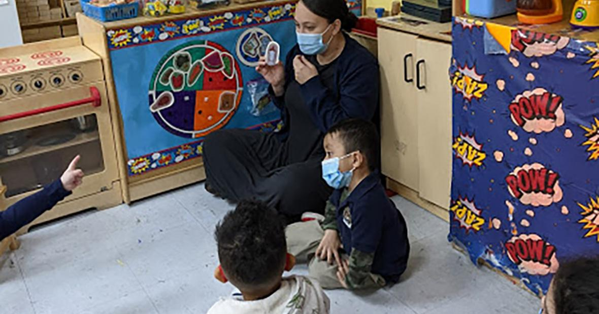 Early Childhood teacher working with students