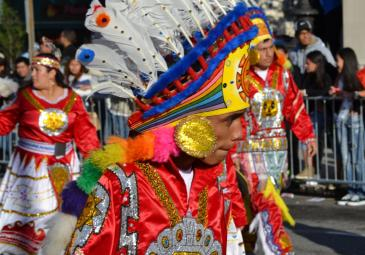ethnic immigration studies parade male colorful costume
