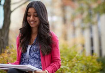 applications deadlines grid female student smiling outside