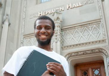 male honors program student in front of hepburn hall