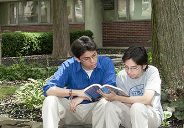 international students reading outside admissions thumbnail