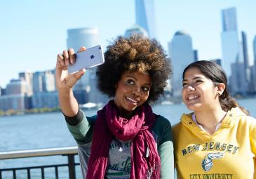 two women taking a photo