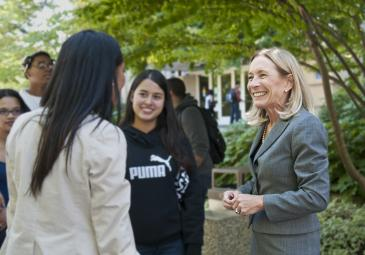sue henderson talking with female students