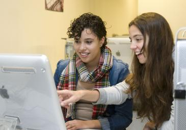 two female students computer lab