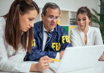 Two women with FBI worker