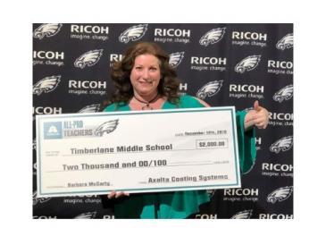 Barbara McCarty holding large check