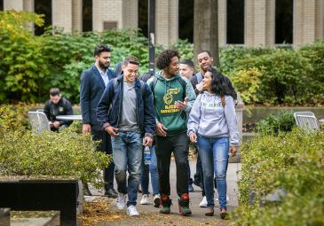 Diverse group of students walking on campus
