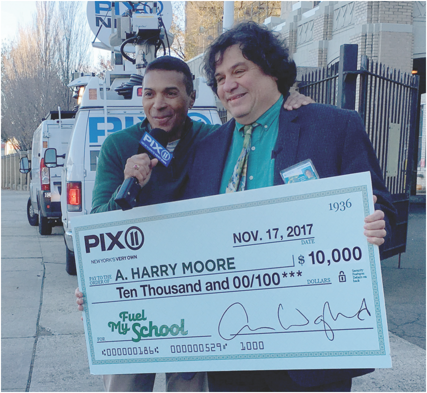 Check from PIX11 handed to representative of A Harry Moore School.