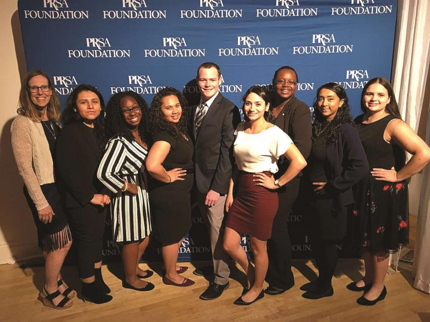 NJCU Alumni pose in front of PRSA Foundation backdrop.