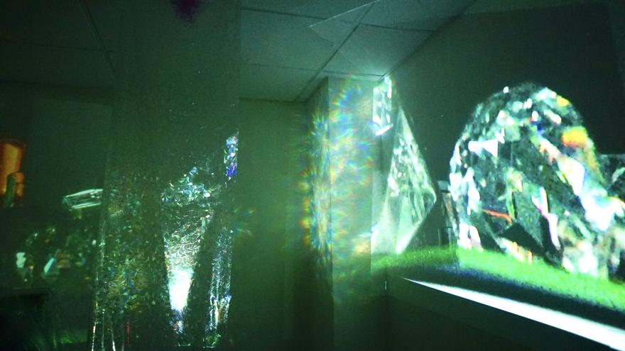 Projection of images on a wall depicting refraction of light.