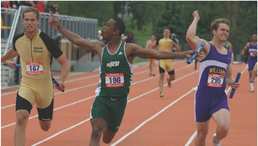 NJCU men's track runner in the lead of a relay race.