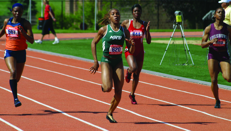NJCU women's track runner in the lead.