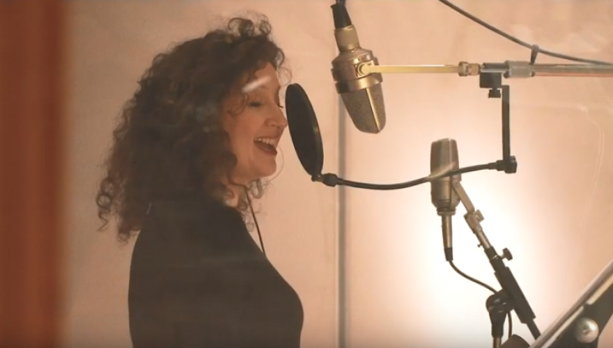 Svetlana singing in recording booth