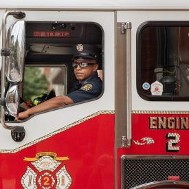 firefighter in firetruck with sunglasses