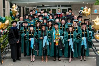 Students at Hooding Celebration